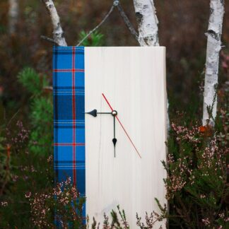 Wooden clock Estonian tartan in a bog